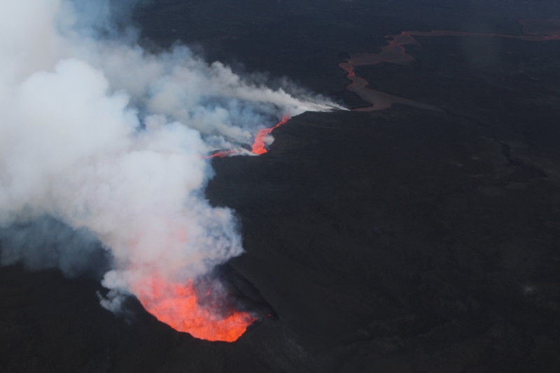 Holuhraun fissure eruption on the flanks of the Bárðarbunga volcano in central Iceland on Oct. 4, 2014, showing the development of a lava lake in the foreground. Vapor clouds over the lava lake are caused by degassing of volatile-rich basaltic magma. Credit: Morten S. Riishuus, Nordic Volcanological Institute