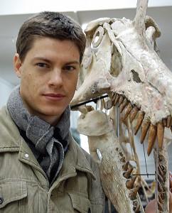 Christophe Hendrickx stands before a Spinosaurus skull.