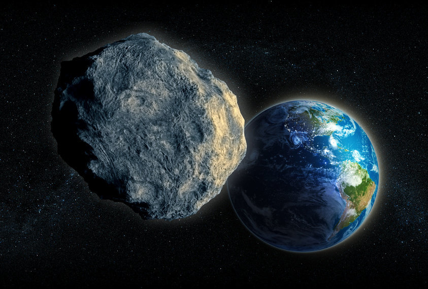 Artist's impression of large asteroid closing in on Earth (stock image). Credit: © Mopic / FotoliaClose
