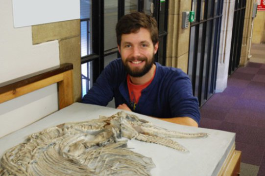 Jonathan Hanson with the ichthyosaur skeleton at the School of Earth Sciences. Credit: Image courtesy of University of Bristol