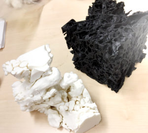 These 3-D printed models show a magnified sample of pumice (black) and a large concentration of gas (white) filling interconnected pores within that pumice sample. (Credit: Berkeley Lab)