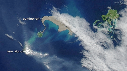 """In this 2006 satellite image, a large """"raft"""" of floating pumice stones (beige) appears following a volcanic eruption in the Tonga Islands. (Credit: Jesse Alan/NASA Earth Observatory, Goddard Space Flight Center)"""