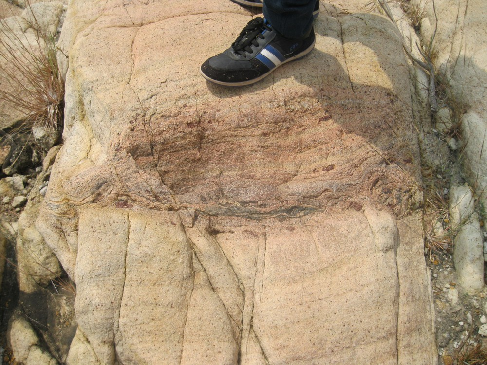 Partial Rock melting feature on outcrop .@World Fossil Society,Riffin T Sajeev,Russel T Sajeev