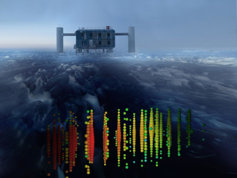 This image shows a visual representation of one of the highest-energy neutrino detections superimposed on a view of the IceCube Lab at the South Pole. Credit: IceCube Collaboration